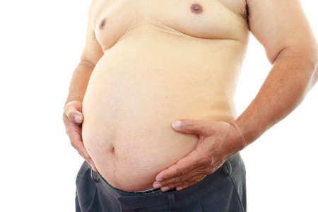 The obesity man who is worried about a stomach photo