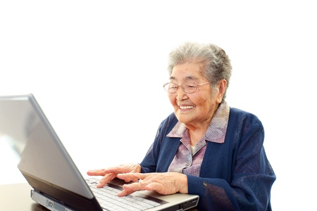 Senior woman with laptop at the desk