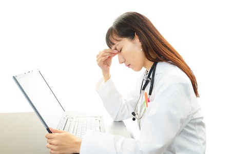 concerned doctor thinking about some problems photo