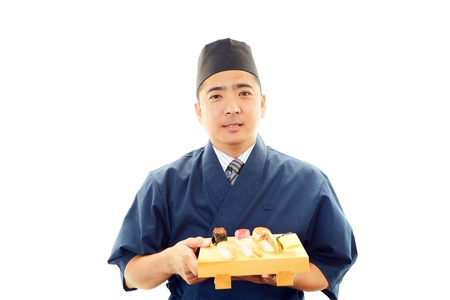Japanese chef who cooks a dish photo