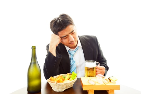 pay cuts: The businessman who drank liquor too much Stock Photo