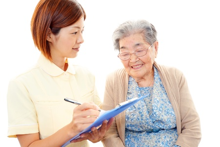 health concern: An elderly lady and nurse of the smile