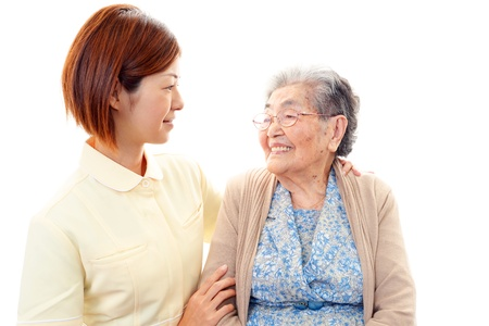 frailty: An elderly lady and nurse of the smile