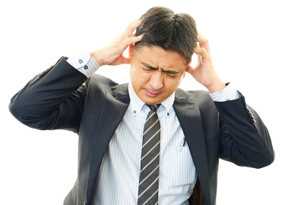 pay cuts: Tired and stressed asian businessman Stock Photo