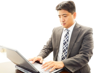 The businessman who works with a PC photo