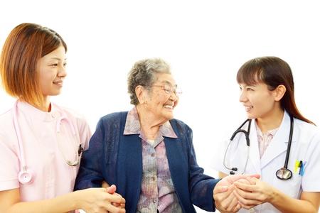 Friendly nurse cares for an elderly woman