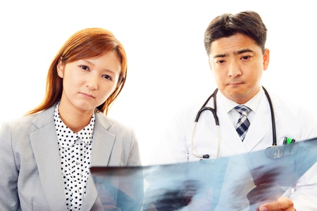explains: The doctor who explains a symptom Stock Photo