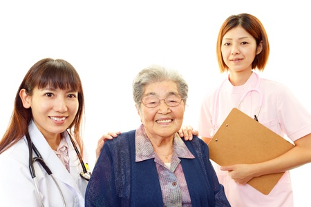 Old wonan and the medical staff of smile Stock Photo - 19904690