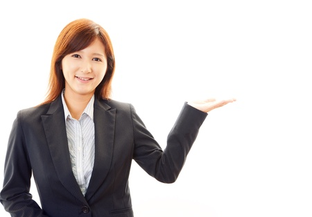 Beautiful business woman showing something with her hand Stock Photo - 19904740