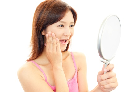 The woman who is doing skin care photo