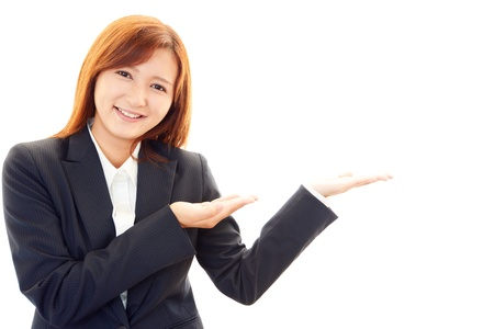 Beautiful business woman showing something with her hand Stock Photo - 19949458