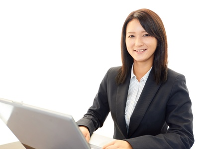 The female office worker who poses happily Stock Photo - 19993287