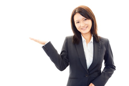 Beautiful business woman showing something with her hand photo