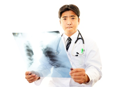Doctors with Chest X-ray Stock Photo - 19993215