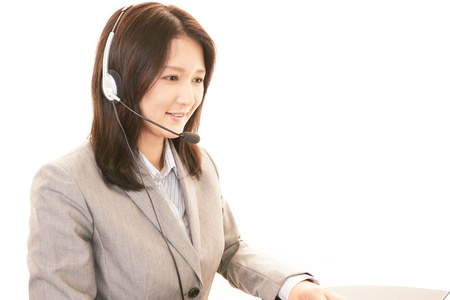 Woman with a handset Stock Photo - 20111608