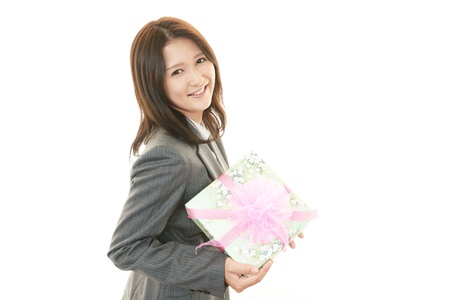 women s health: Smiling woman with a gift