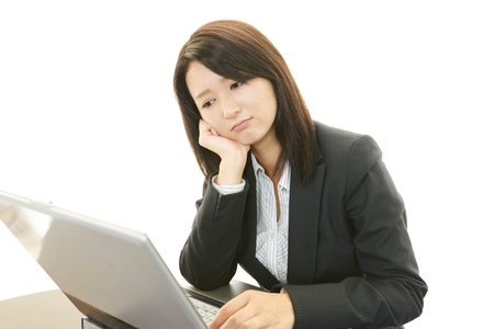 Tired and stressed young Asian woman Stock Photo - 20112971