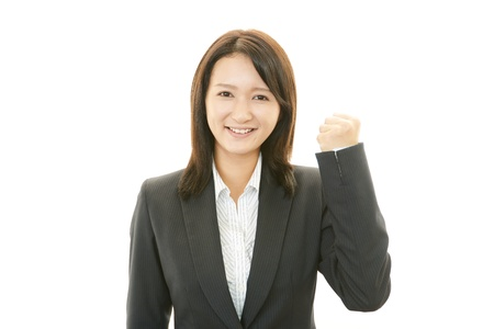 The female office worker who poses happily photo