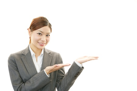 Beautiful business woman showing something with her hand Stock Photo - 20112962