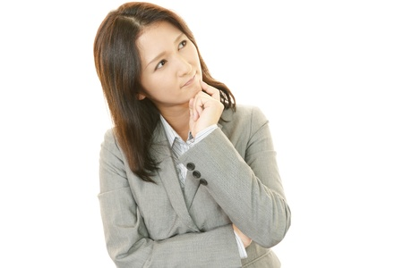 Tired and stressed young Aian woman Stock Photo - 20112981