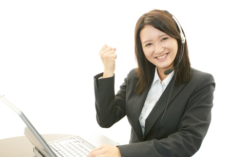 Woman with a handset Stock Photo - 20112897