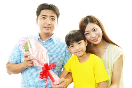 The girl who hands father a bouquet photo