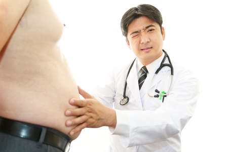 Serious doctor examining a patient obesity Stock Photo - 24847775