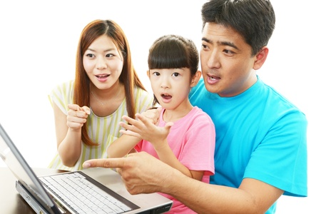 Family With Notebook photo