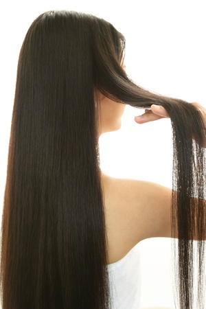 hair treatment: Woman taking care of her hair