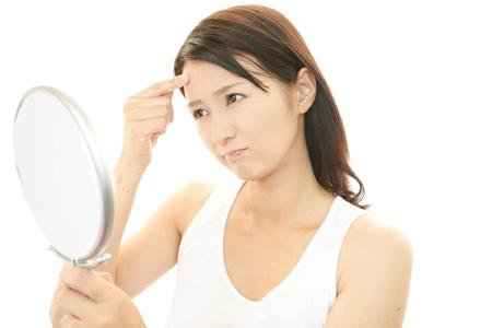 Woman uneasy look  Standard-Bild