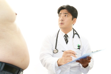 metabolic: Serious doctor examining a patient obesity
