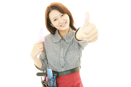 Smiling Asian hairdresser photo