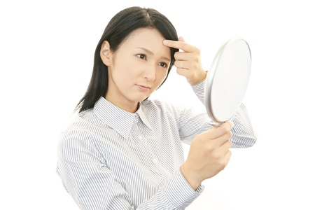 Woman uneasy look  版權商用圖片