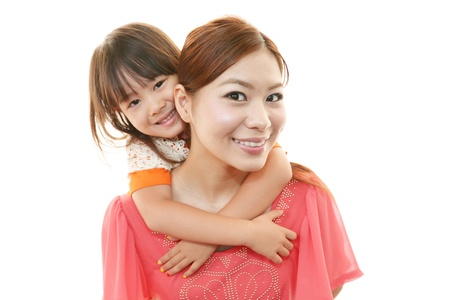Lachend kind met moeder Stockfoto