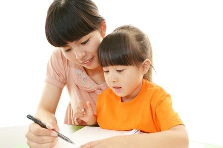 Little Asian girl studying