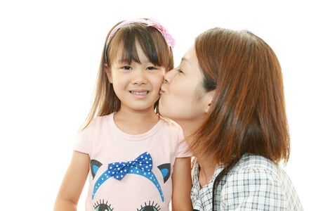 Smiling child with mother photo