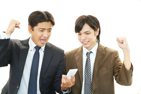 Happy men holding smart phone photo