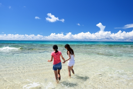 Parent and child playing at the beach photo