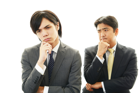 Stressed Asian businessmen  photo