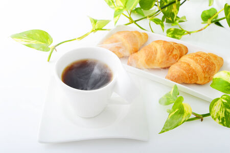 Breakfast with coffee and croissants photo