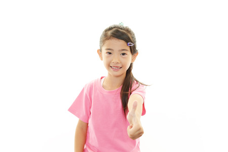 Happy girl showing thumb up sign photo