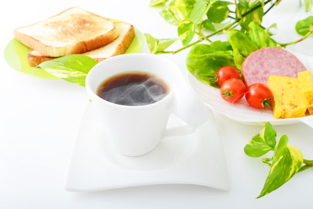 Cup of coffee with foods photo