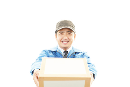 Asian courier delivering a package photo