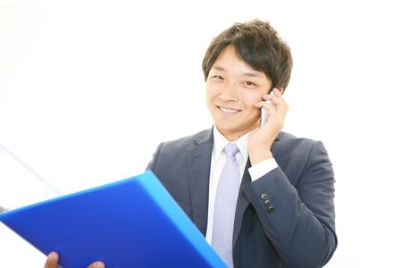 通信: Happy man holding smart phone  写真素材