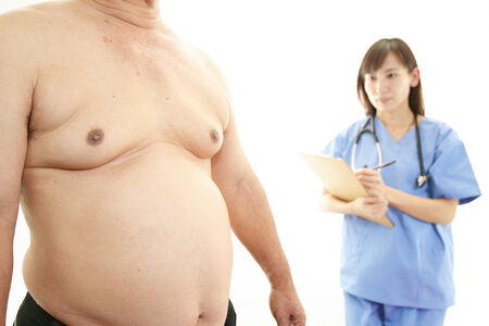Woman doctor with a medical examination in obese patient photo