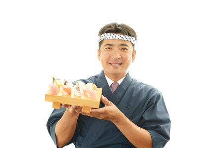 liveliness: Portrait of a sushi chef Stock Photo