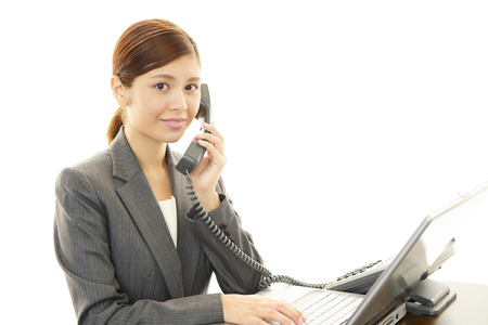 phon: Business woman with phon Stock Photo