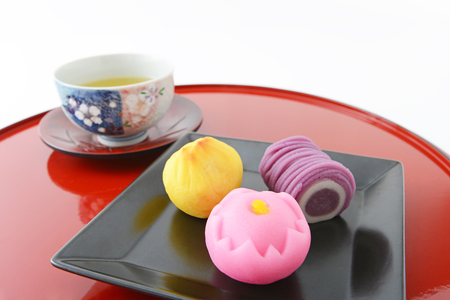 lacquerware: Japanese sweets and green tea Stock Photo