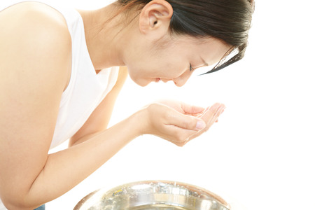 Woman washing her face 写真素材