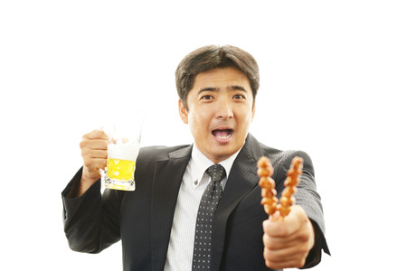 Man drinking beer photo